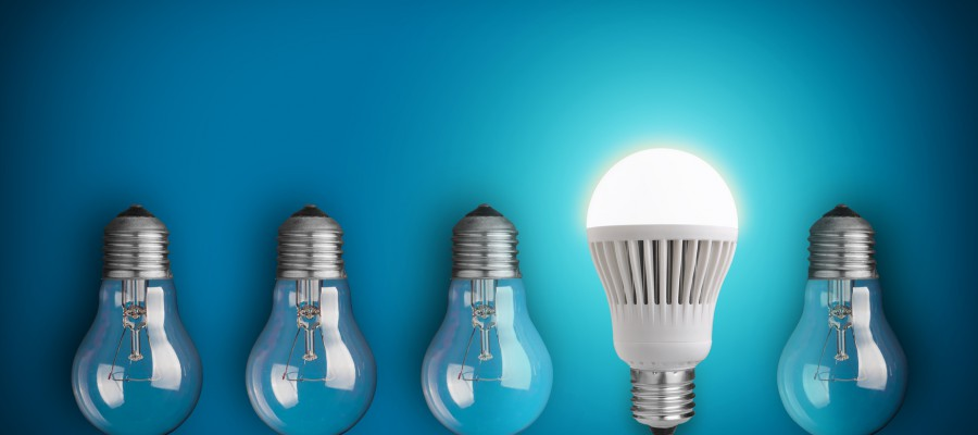 Idea concept with row of light bulbs and glowing LED bulb