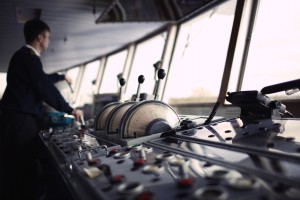 Navigation officer driving the ship on the river.