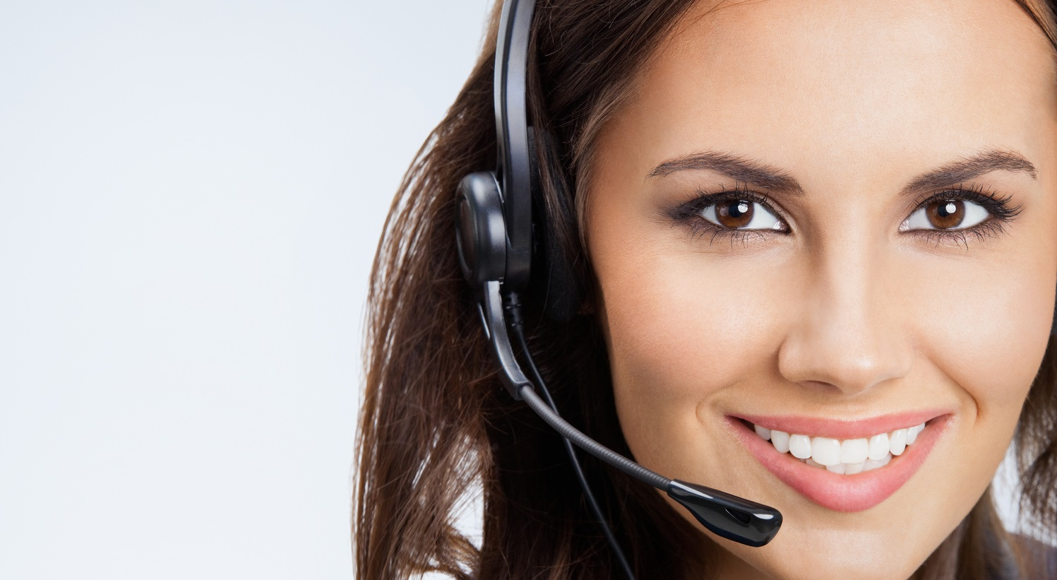 Portrait of happy smiling young support phone operator