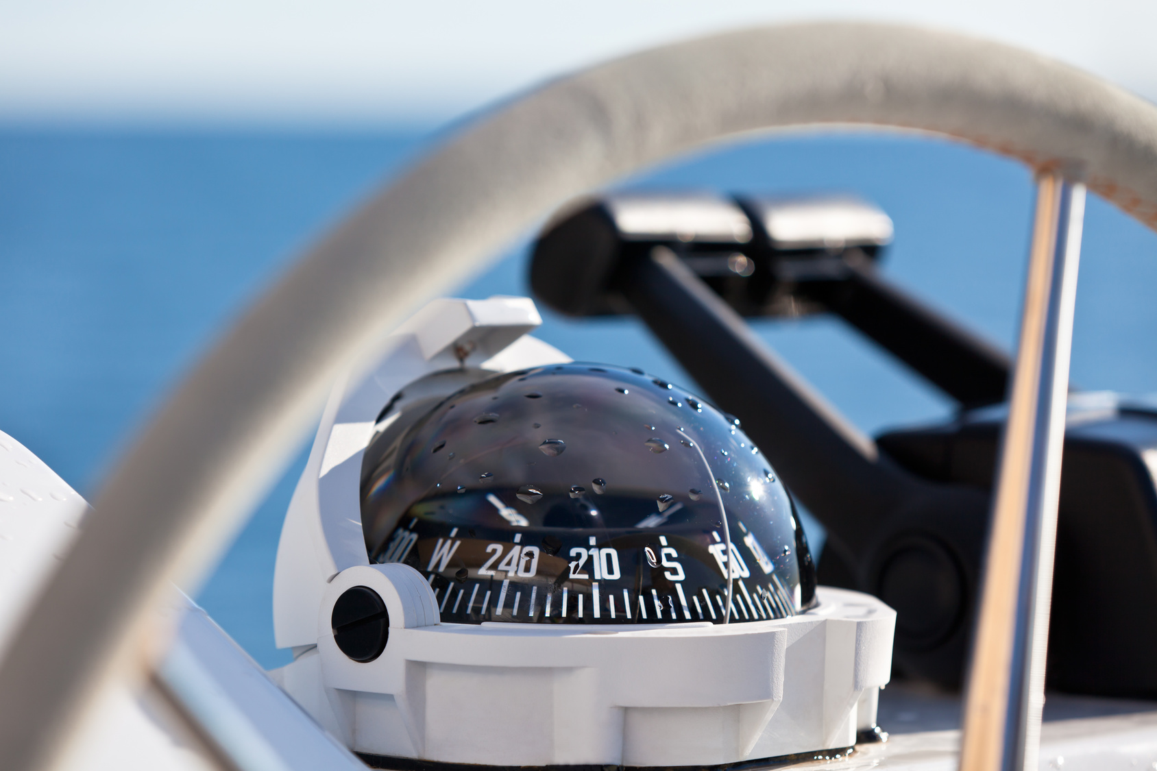 Sailing yacht control wheel and implement. Horizontal shot without people